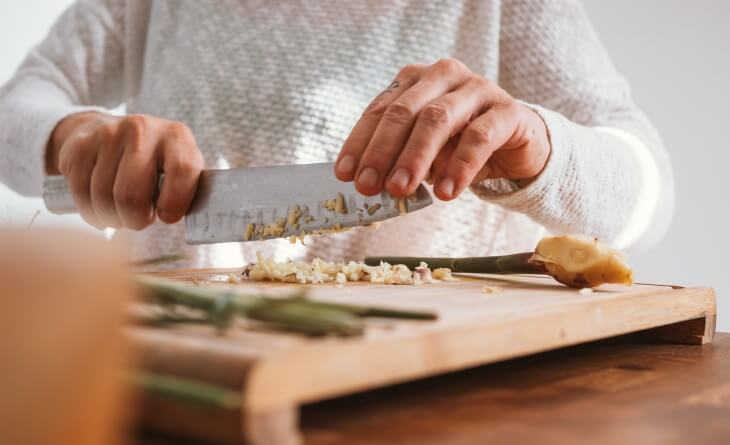 Person chopping vegetables